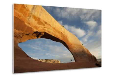 A Young Girl Running in a Sandstone Arch-Peter Mather-Metal Print