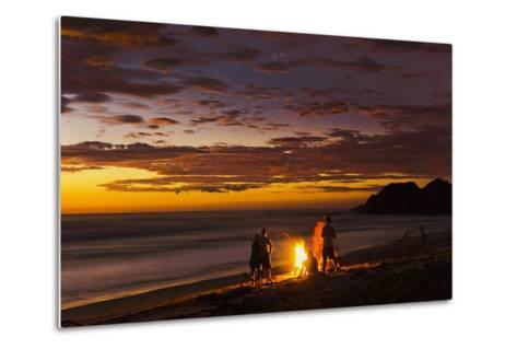People with Driftwood Fire at Sunset on Playa Guiones Beach-Rob Francis-Metal Print