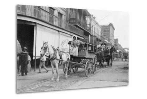 Woman Driving Horse-Drawn Wagon on Street--Metal Print