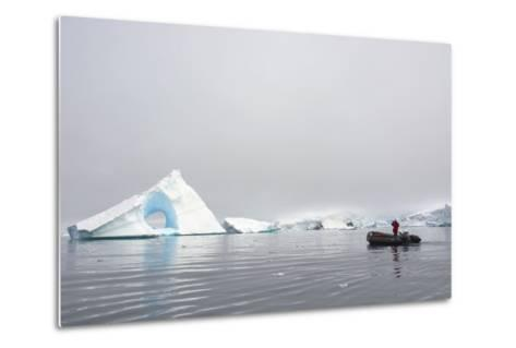 Antarctica. Charlotte Bay. Giant Iceberg with a Hole-Inger Hogstrom-Metal Print