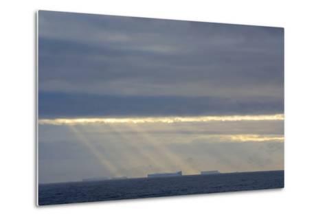Antarctica. Crepuscular Rays Shining Down onto Tabular Icebergs-Inger Hogstrom-Metal Print