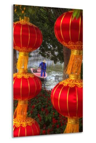 Worker in Boat Cleaning Green Lake, Kunming China-Darrell Gulin-Metal Print