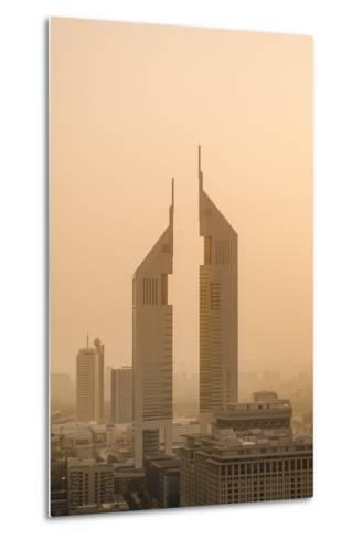 Sunset Engulfs the Jumeirah Emirates Towers Hotel Dubai, Uae-Michael DeFreitas-Metal Print