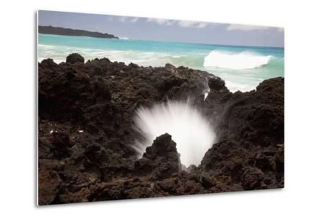 Hawaii, Maui, La Perouse Bay, a Burst of Water Through a Blowhole in Some Lava Rocks-Design Pics Inc-Metal Print