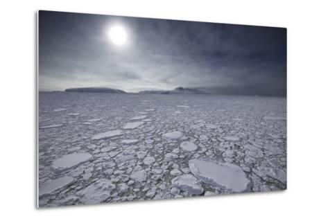 The Sun Shines over Ice Pack in the Grandidier Channel-Jim Richardson-Metal Print