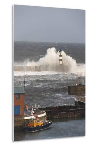Seaham, Teesside, England; Waves Crashing into a Lighthouse and a Boat Along the Pier-Design Pics Inc-Metal Print