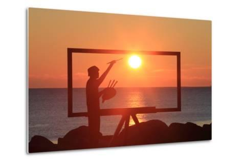 A Sculpture of an Artist Painting in New Castle, New Hampshire Frames the Sunrise-Robbie George-Metal Print