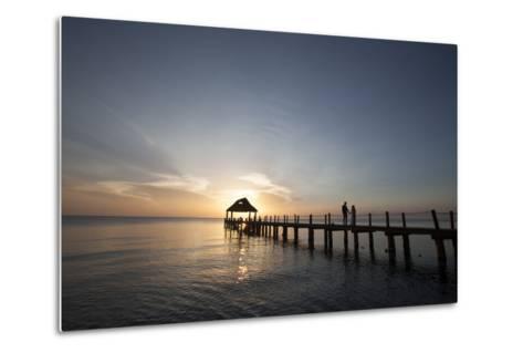 Newlyweds Walk Along a Pier on the West Coast of Cozumel Island-Michael and Jennifer Lewis-Metal Print