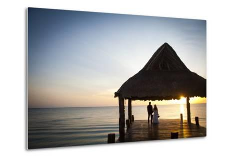 Newlyweds Watch the Sunset after their Beach Wedding on the West Coast of Cozumel Island-Michael Lewis-Metal Print