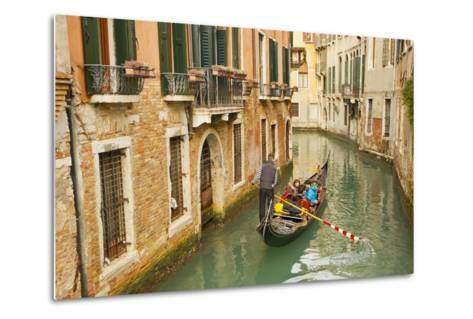 Tourists Ride in a Gondola in a Canal Winding Through Venice-Mike Theiss-Metal Print