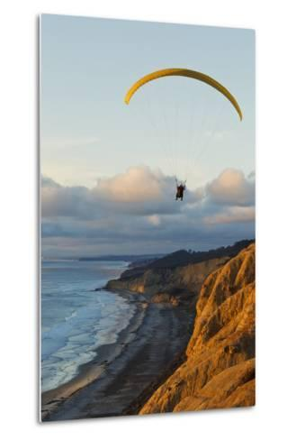California, La Jolla, Paraglider Flying over Ocean Cliffs at Sunset. Editorial Use Only-Design Pics Inc-Metal Print