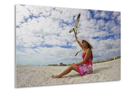 A Laughing Gull Swoops Down for a Cookie in a Woman's Hand at the Beach-Mike Theiss-Metal Print