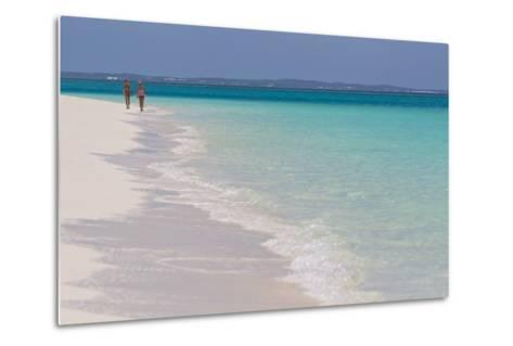 Two People Walking Down the Beach at Grace Bay on the Caribbean Sea-Mike Theiss-Metal Print