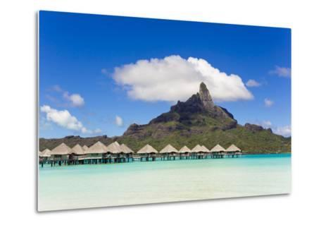Bungalows on Stilts in a Lagoon with Mount Otemanu in the Near Distance-Mike Theiss-Metal Print