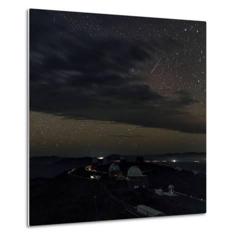 A Meteor Appears Next to the Beehive Star Cluster (M44) Above La Silla Telescope Domes-Babak Tafreshi-Metal Print