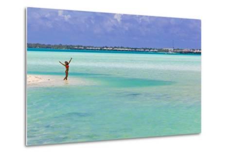 A Woman in a Bikini Posing in the Turquoise Waters at Bora Bora-Mike Theiss-Metal Print