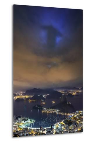 The Shadow of Christ the Redeemer Projected on to Clouds above Rio De Janeiro.-Jon Hicks-Metal Print