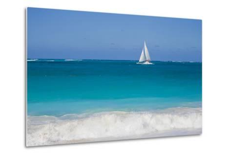 Surf Surges onto a Beach as a Sailboat Passes Offshore-Mike Theiss-Metal Print