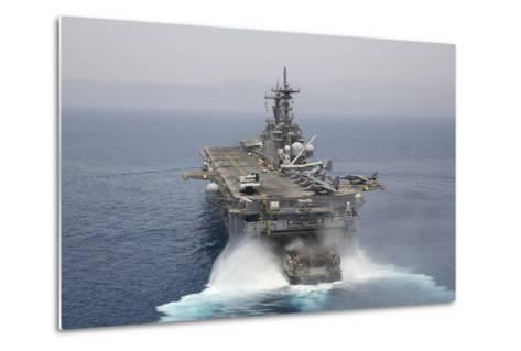 A Landing Craft Air Cushion Enters the Well Deck of USS Kearsarge--Metal Print
