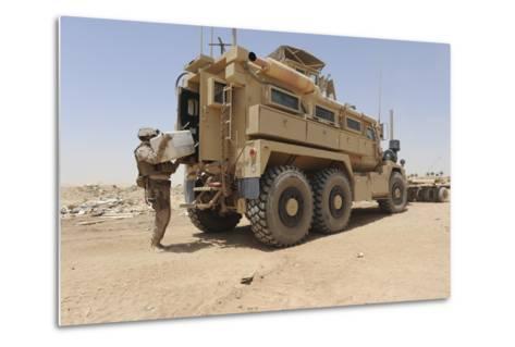 Hospital Corpsman Loads Up a Mine Resistant Ambush Protected Vehicle--Metal Print