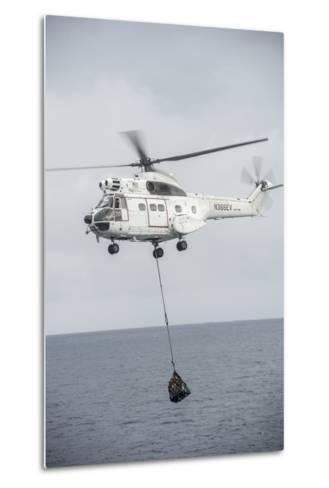An SA-330 Puma Transport Helicopter Moves Cargo During a Vertical Replenishment--Metal Print