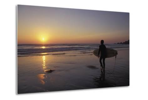 Silhouetted Surfer on Sandy Beach at Sunset-Design Pics Inc-Metal Print