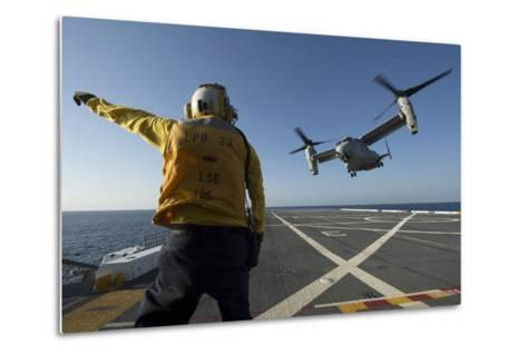Aviation Boatswain's Mate Directs an MV-22 Osprey as it Launches from the Flight Deck--Metal Print