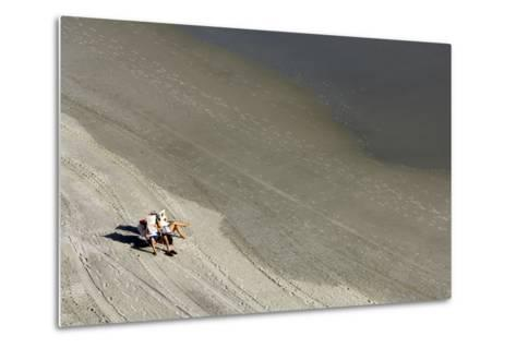 A Couple Relax While Reading Newspapers at the Beach-Jim Reed-Metal Print