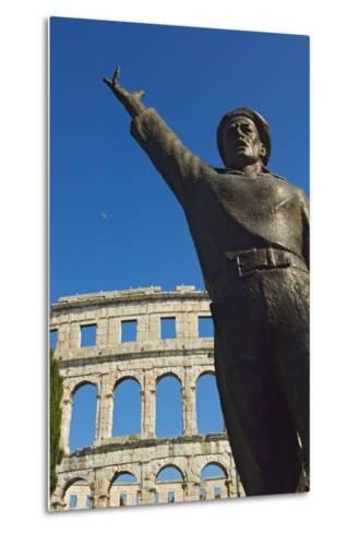 Bronze Statue in Front of Roman Amphitheater-Design Pics Inc-Metal Print