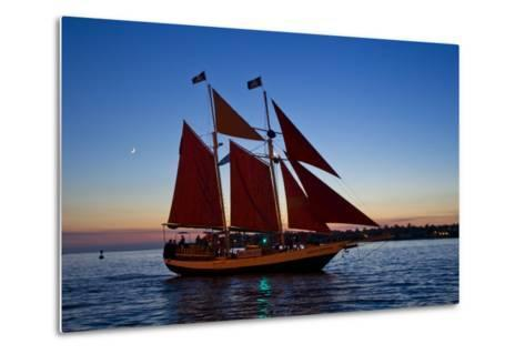 A Sailboat Carrying Tourists Returns to Port after a Sunset Sail-Mike Theiss-Metal Print