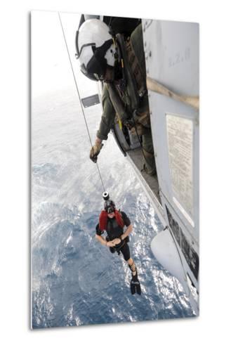Aircrewman Assists in Hoisting a Member into an Mh-60S Sea Hawk--Metal Print