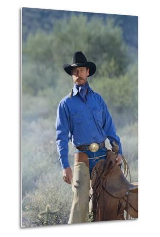 Cowboy with His Saddle-DLILLC-Metal Print