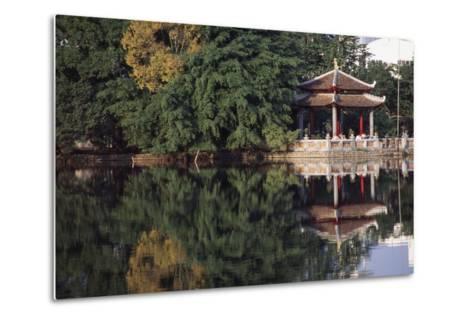 People Resting under Pagoda on Hoan Kiem Lake Shore-Design Pics Inc-Metal Print