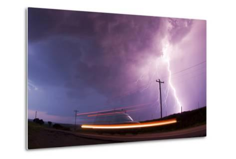 A Large Lightning Bolt Strikes Behind a Storm Chaser's Moving Van-Mike Theiss-Metal Print