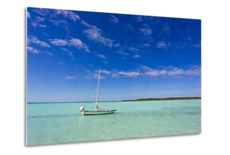 A Lone Sailboat Anchored in Turquoise Water-Mike Theiss-Metal Print