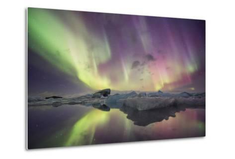 Iceland, Jokulsarlon. Aurora lights reflect in lagoon.-Josh Anon-Metal Print