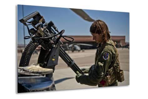 Airman Examines the Barrels of a Gau-2 Mini Gun on an Hh-60 Pave Hawk--Metal Print