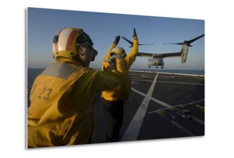 Aviation Boatswain's Mates Direct an MV-22 Osprey on the Flight Deck--Metal Print