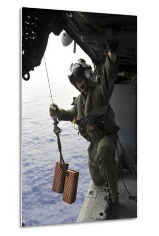 Naval Aircrewman Conducts a Search and Rescue Drill on an Mh-60S Sea Hawk--Metal Print
