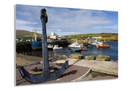 An Anchor Stands on the Shore Overlooking Fishing Boats in Portmagee-Chris Hill-Metal Print