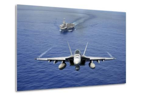 An F-A-18E Super Hornet Flying Above USS John C. Stennis--Metal Print