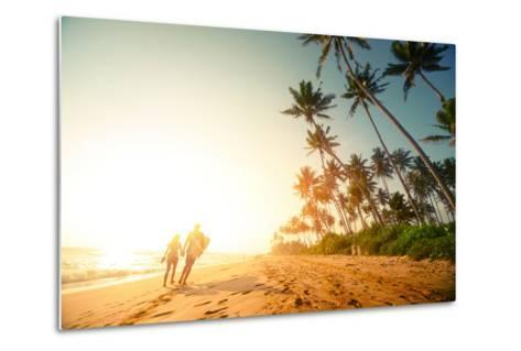 Couple Walking on the Sandy Beach with Palm Trees-Dudarev Mikhail-Metal Print