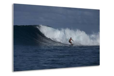 Surfing a Wave Off Tahiti Island-Andy Bardon-Metal Print