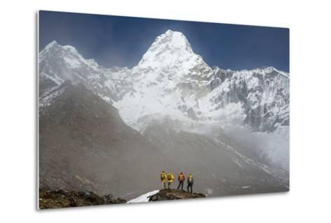 A Climbing Team Stand Looking Up at Ama Dablam in the Everest Region of Nepal-Alex Treadway-Metal Print