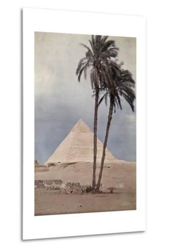 Palm Trees Stands in the Foreground of One of the Pyramids of Giza-Gervais Courtellemont-Metal Print