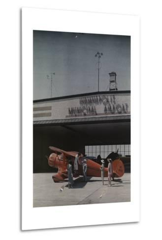 A Woman Exits a Plane with Help While Other People Watch-Willard Culver-Metal Print