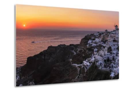 Sunset over the Aegean Sea Seen from a Cliff-Top Town on Santorini Island-Babak Tafreshi-Metal Print