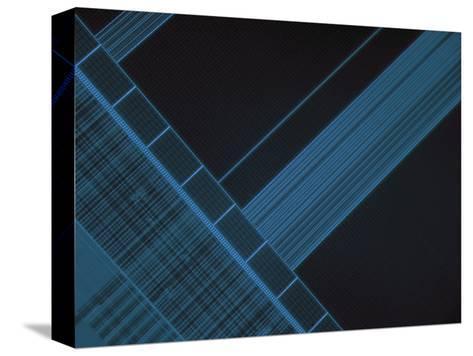 Micrograph of Computer Microprocessor, LM X200, Epifluorecence, UV Illumination-Robert Markus-Stretched Canvas Print