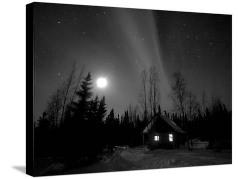 Cabin under Northern Lights and Full Moon, Northwest Territories, Canada March 2007-Eric Baccega-Stretched Canvas Print