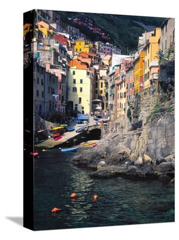 Harbor View of Hillside Town of Riomaggiore, Cinque Terre, Italy-Julie Eggers-Stretched Canvas Print